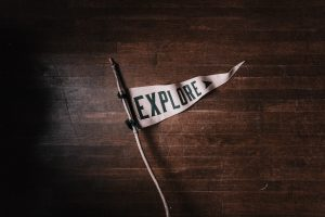 White pennant with the word Explore on it