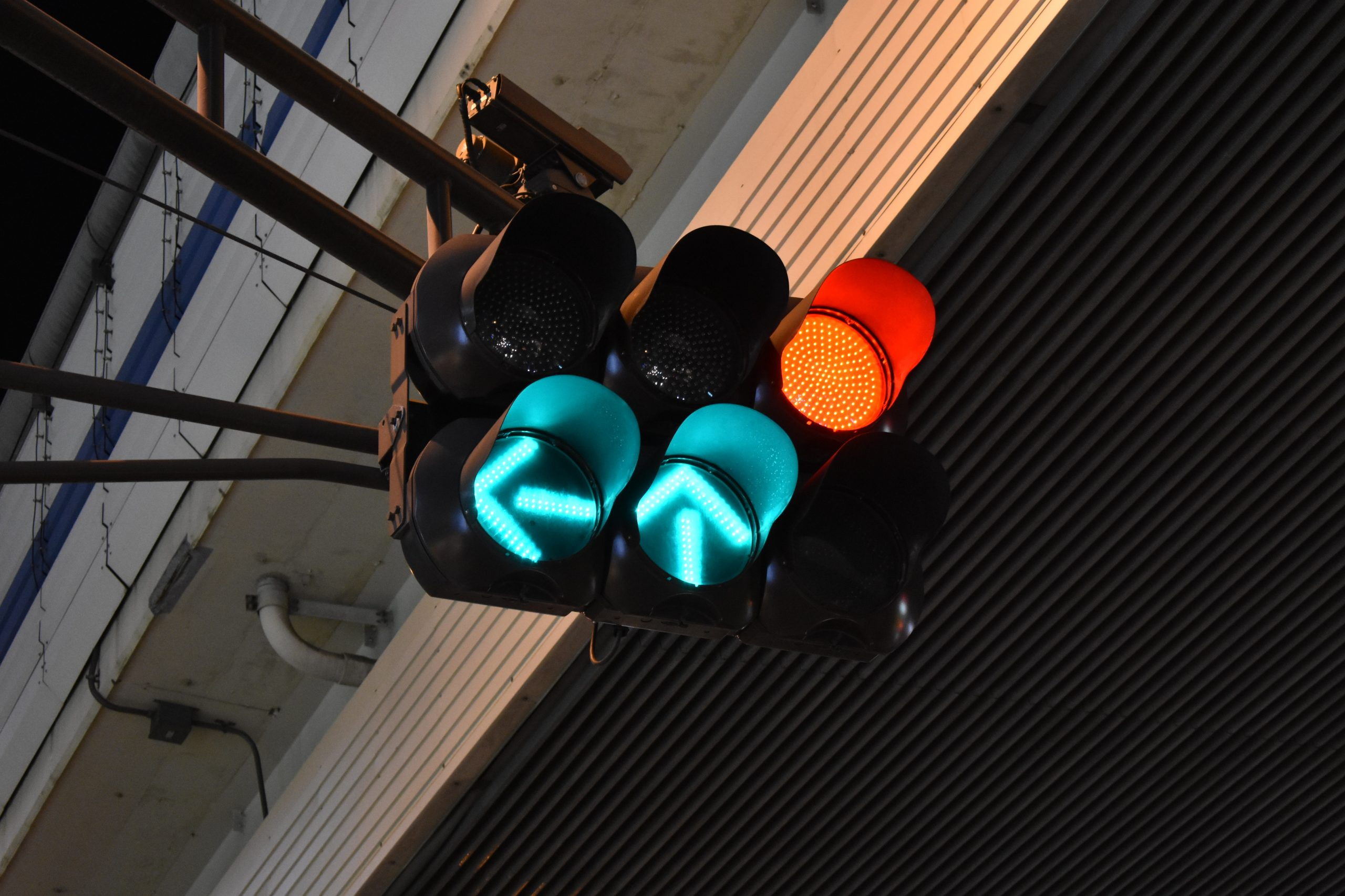 Traffic signal with green arrows for straight and left terns
