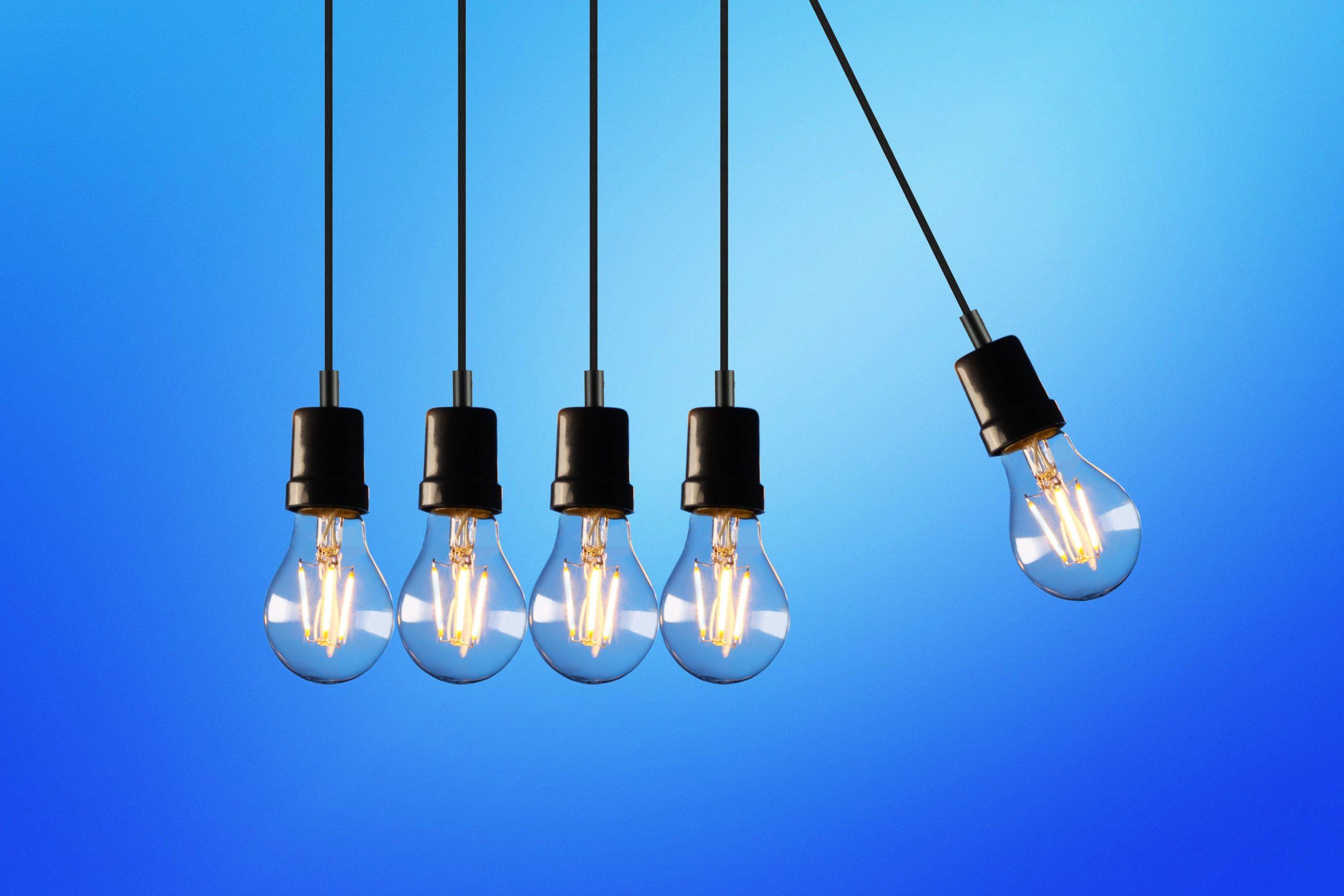 Five hanging lightbulbs